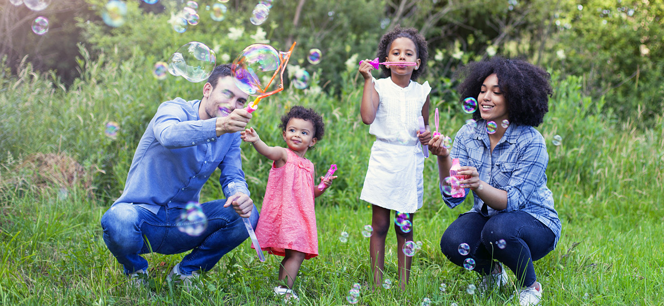 Happy Family Blowing Bubbles - Family Preservation Foundation